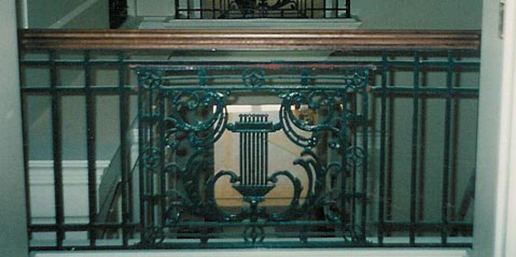 iron-anvil-railing-scrolls-and-patterns-window-top-christensen-12-1030-1