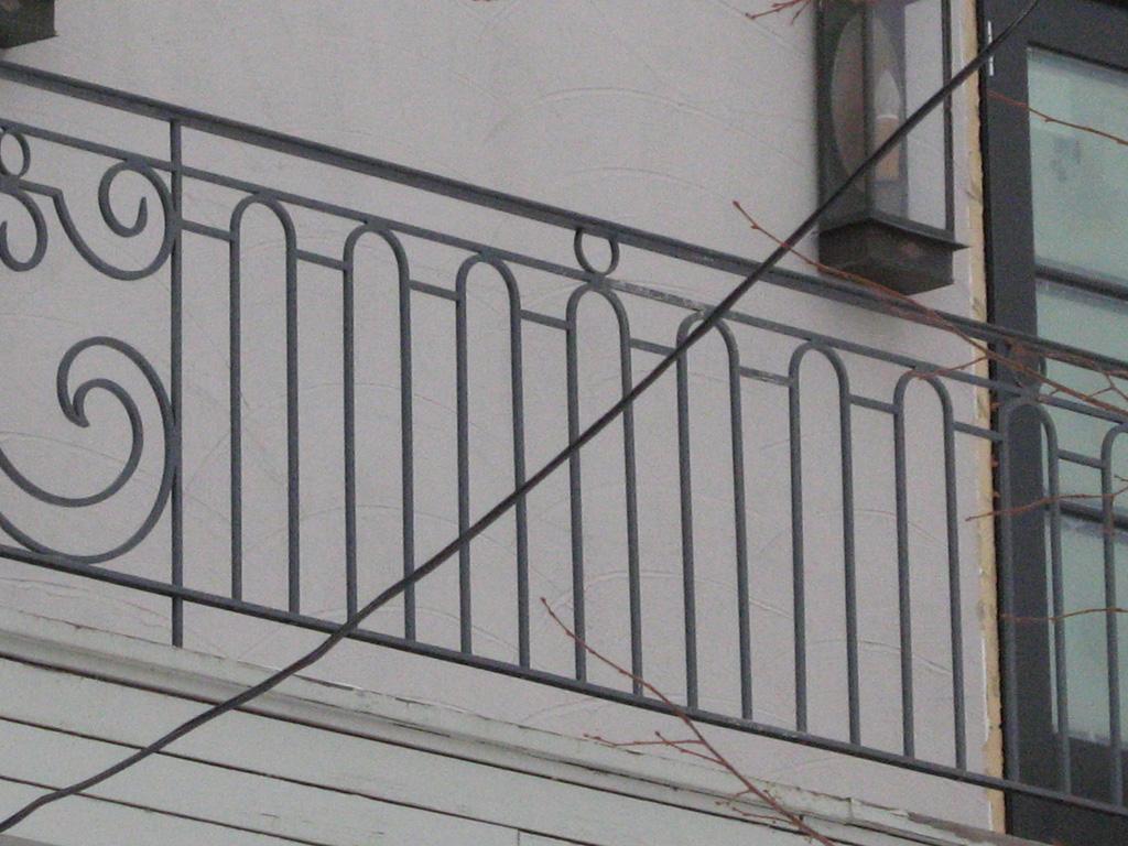 iron-anvil-railing-scrolls-and-patterns-window-top-circles-graner-scroll-rail-loop-arlington-slc-3