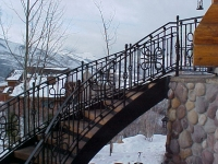 iron-anvil-railing-scrolls-and-patterns-panels-castings-circular-stair-park-city-3