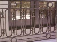 iron-anvil-railing-scrolls-and-patterns-repeating-circles-la-brett-job-14197-peter-mousdkondis-6