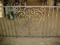 iron-anvil-railing-scrolls-and-patterns-window-bishop-curved-rail-1