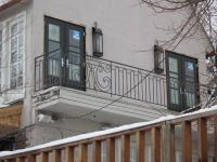 iron-anvil-railing-scrolls-and-patterns-window-top-circles-graner-scroll-rail-loop-arlington-slc-1
