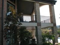 iron-anvil-railing-single-top-collars-ferran-kilgore-gate-grand-stair-railing-3