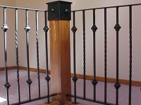 iron-anvil-railing-single-top-collars-rail-with-large-wood-post-wraps-park-city-burnside