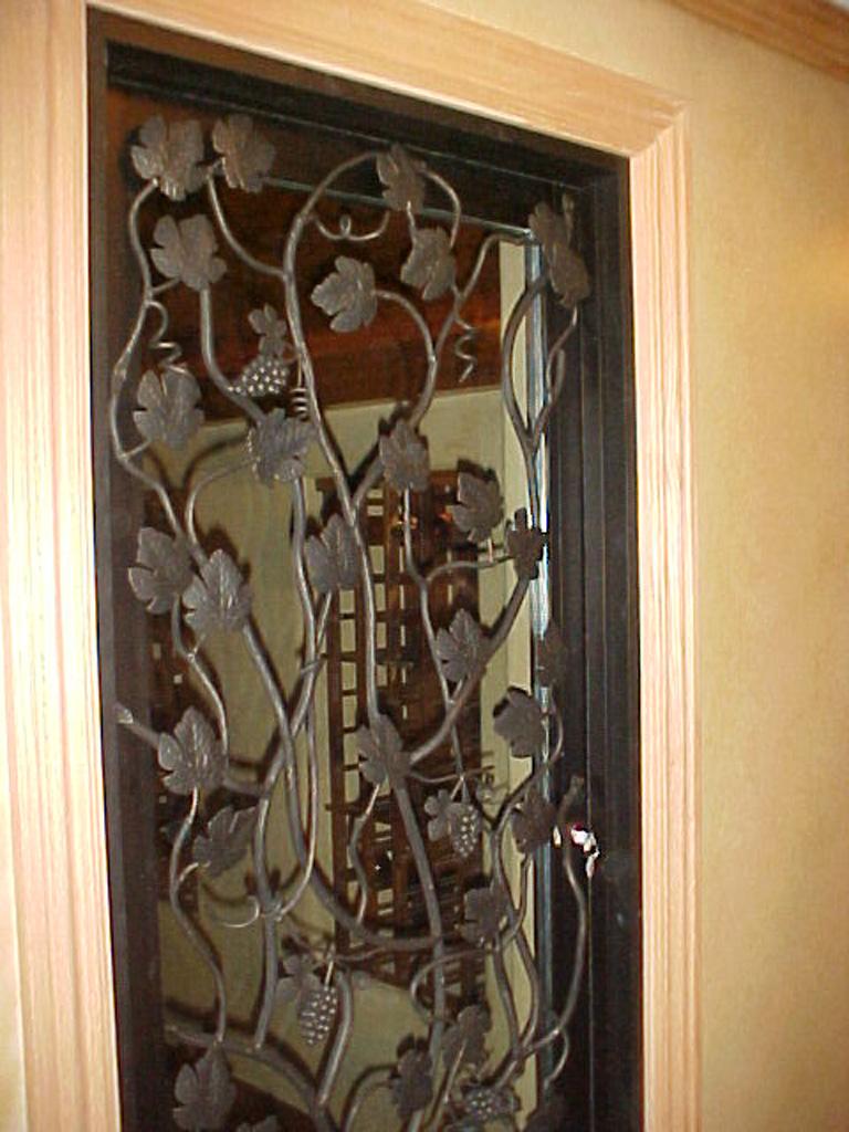 iron-anvil-security-doors-single-goldthorpe-gate-wine-room-2