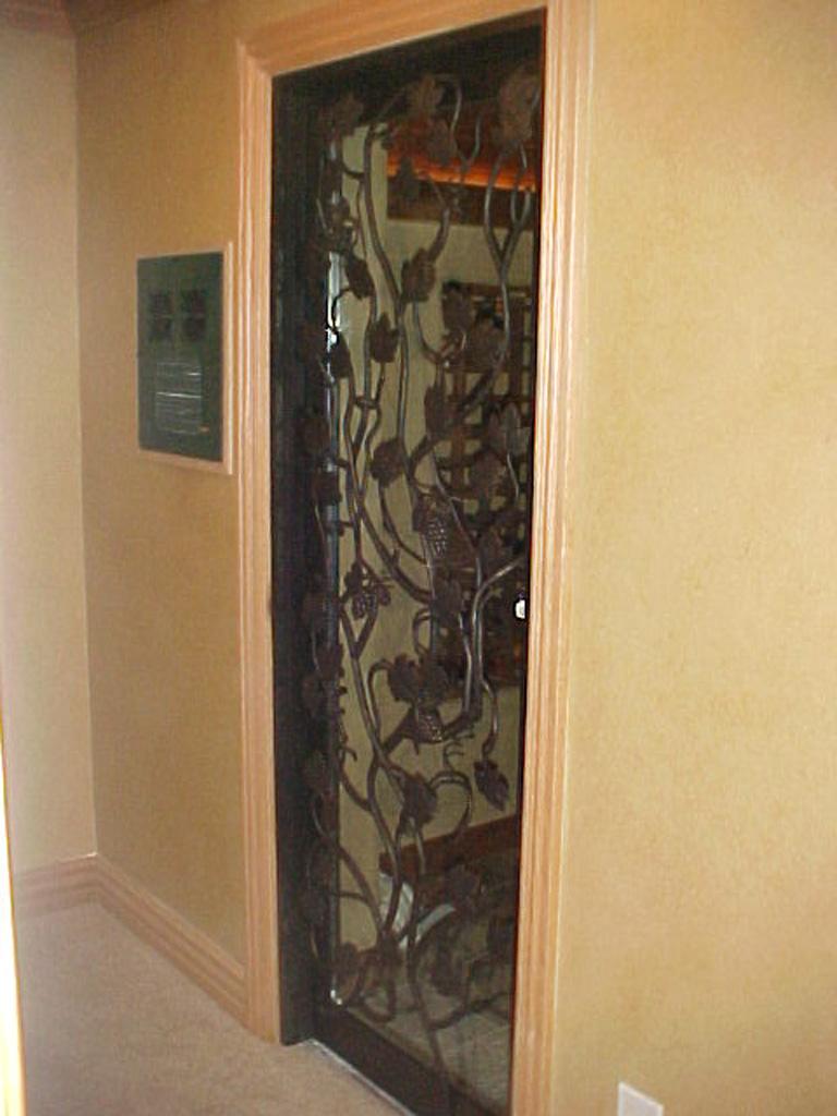 iron-anvil-security-doors-single-goldthorpe-gate-wine-room-3