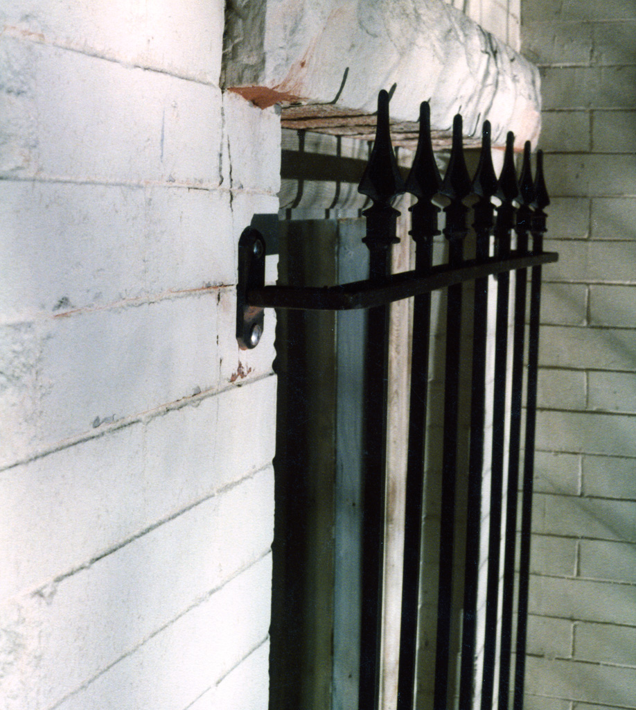 iron-anvil-security-window-guards-mount