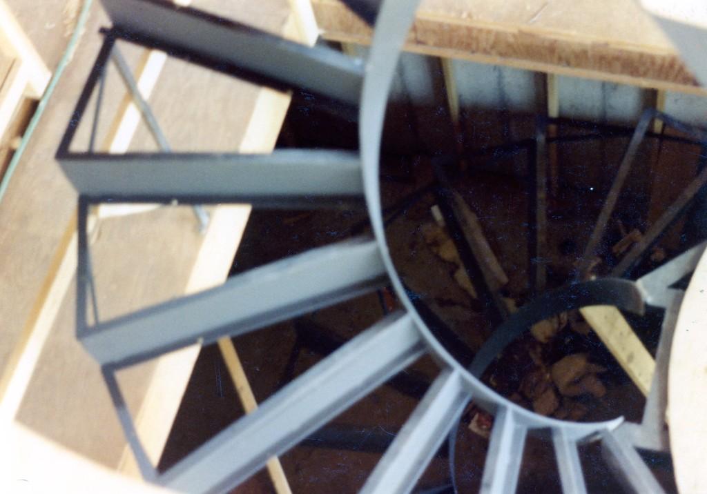 41-0010-iron-anvil-stairs-grand-circular-treads-angle-iron-park-city-1