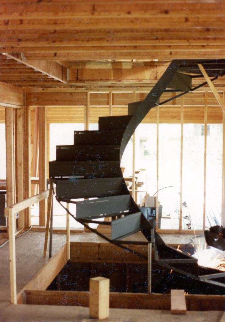 41-0010-iron-anvil-stairs-grand-circular-treads-angle-iron-park-city-2
