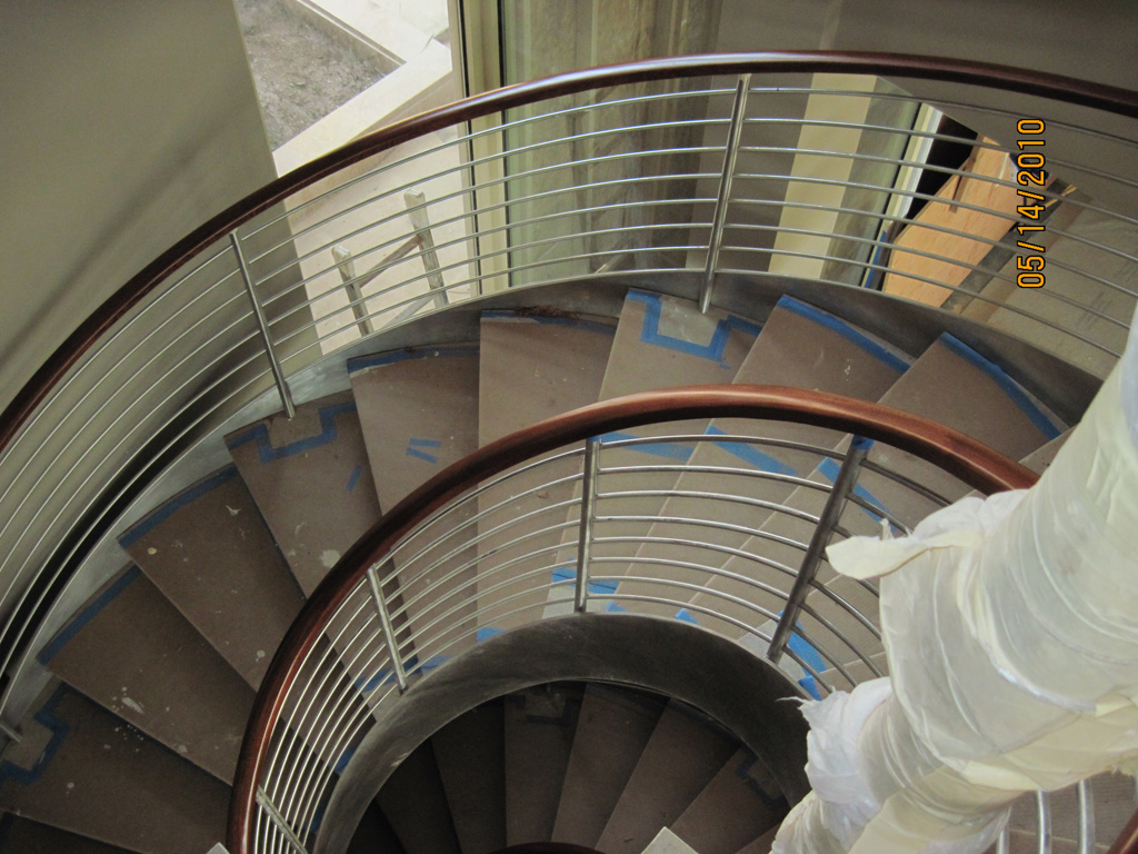 41-0030-iron-anvil-stairs-grand-circular-treads-angle-iron-wood-step-stainless-steel-watts-larson-by-others-2