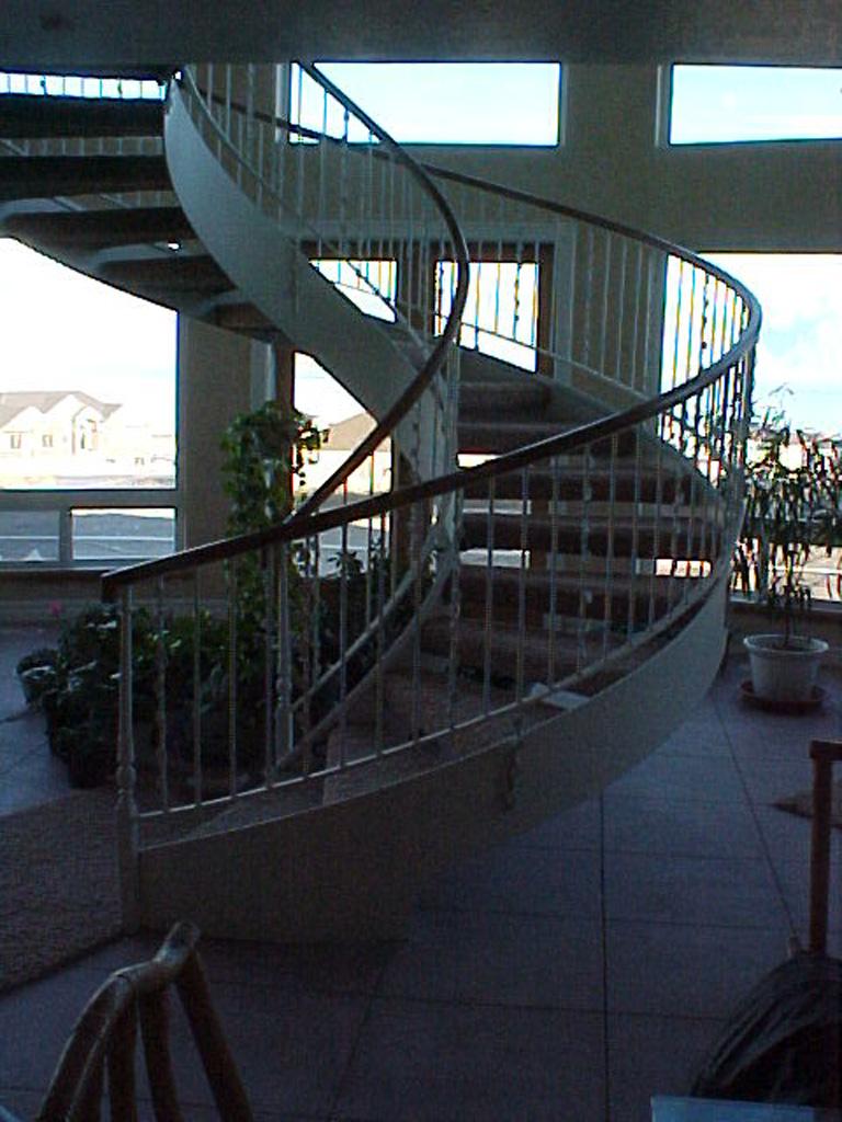 41-0050-iron-anvil-stairs-grand-circular-treads-angle-iron-wood-treads-jensen-wally-stair-saratoga-springs-1