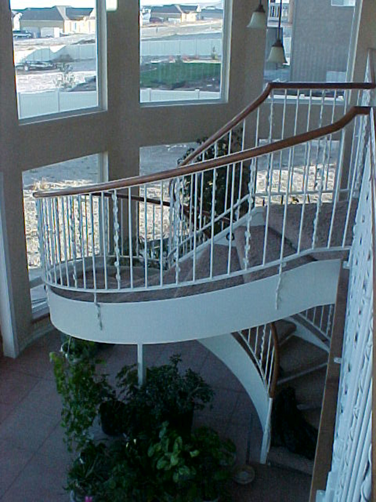 41-0050-iron-anvil-stairs-grand-circular-treads-angle-iron-wood-treads-jensen-wally-stair-saratoga-springs-3