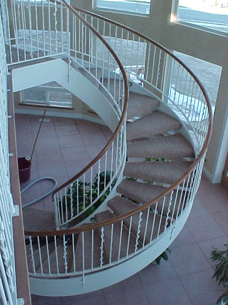 41-0050-iron-anvil-stairs-grand-circular-treads-angle-iron-wood-treads-jensen-wally-stair-saratoga-springs