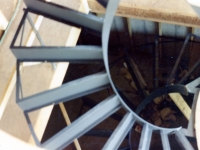 41-0010-iron-anvil-stairs-grand-circular-treads-angle-iron-park-city-1