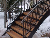 41-0040-iron-anvil-stairs-grand-circular-treads-angle-iron-wood-steps-park-city-3