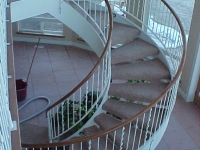 41-0050-iron-anvil-stairs-grand-circular-treads-angle-iron-wood-treads-jensen-wally-stair-saratoga-springs