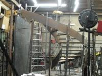 41-0060-iron-anvil-stairs-grand-circular-treads-concrete-13415-ferran-kilgore-2