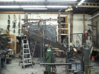 41-0060-iron-anvil-stairs-grand-circular-treads-concrete-13415-ferran-kilgore-3
