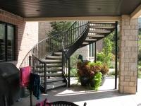41-0060-iron-anvil-stairs-grand-circular-treads-concrete-13415-ferran-kilgore-5