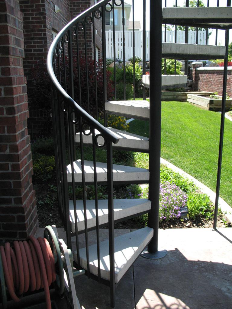 iron-anvil-stairs-spiral-concrete-circles-rail-farmington