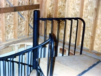 iron-anvil-stairs-spiral-angle-iron-plywood-picket-bend-at-top-41-1028-4