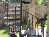 iron-anvil-stairs-spiral-concrete-reverse-over-smooth-cut-out-concrete-krantz-10