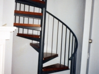 iron-anvil-stairs-spiral-wood-steps-41-1004
