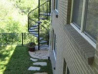 iron-anvil-stairs-spiral-wood-trex-wood-fix-it-wright-1