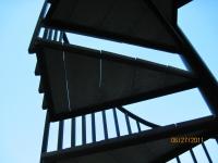 iron-anvil-stairs-spiral-wood-trex-wood-fix-it-wright-10