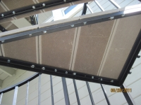 iron-anvil-stairs-spiral-wood-trex-wood-fix-it-wright-5