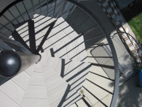 iron-anvil-stairs-spiral-wood-trex-wood-fix-it-wright-7