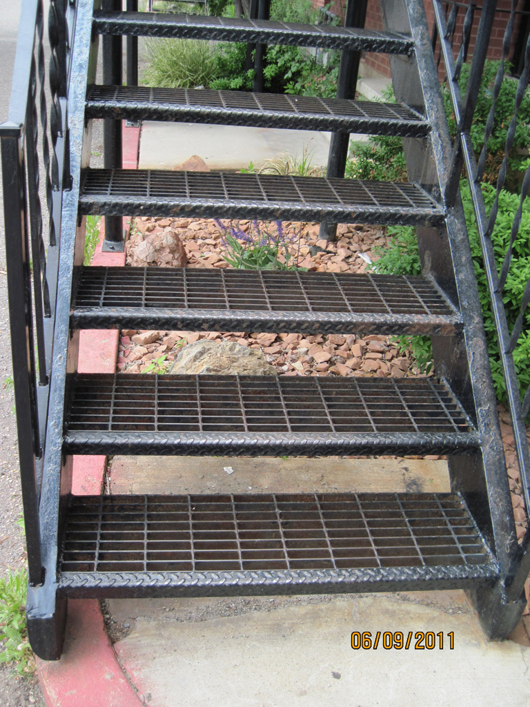 iron-anvil-stairs-double-stringer-treads-bar-grate-apartment-off-holiday-blvd-by-others