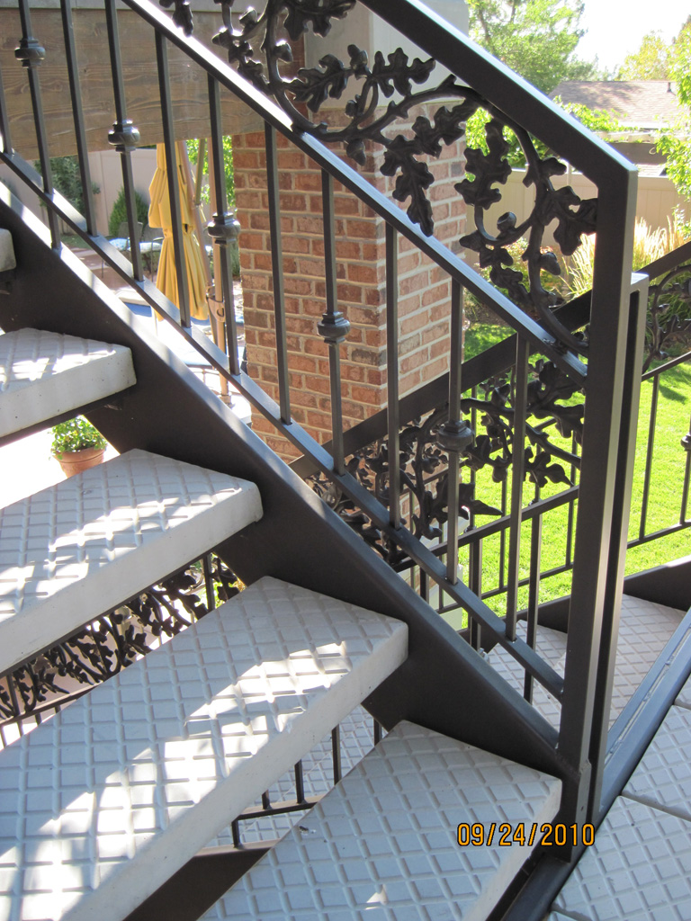 iron-anvil-stairs-double-stringer-treads-concrete-diamond-pattern-gustaferson-5