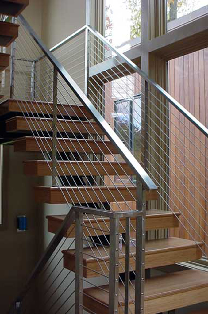 iron-anvil-stairs-single-stringer-treads-wood-by-others-1