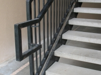iron-anvil-stairs-double-stringer-treads-concrete-smooth-1